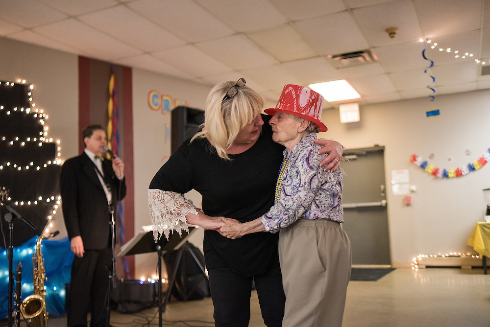 Howard Mohr Community Center Director Karen Dylewski dances with Zenna Sims of Forest Park at the senior New Years's Eve party at the Howard Mohr Community Center on Decemeber 31, 2016.
