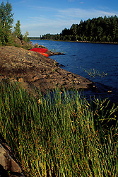 Third Machias Lake, ME. Caneoing. Northern Forest. Red canoes on an island.