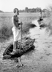 BANGLADESH BARISAL DISTRICT KURULIA SEP94 - A Bengali man stalks his old boat at dusk. Boats are the only means of transport in the swamps of the Ganges River Delta...jre/Photo by Jiri Rezac..© Jiri Rezac 1994