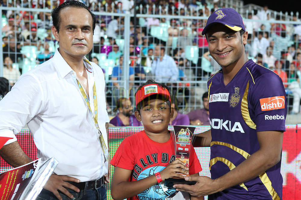 Cricket Attax Winner got the winning trophy from KKR player Sakib Al Hasan during match 63 of the the Indian Premier League ( IPL) 2012  between The Kolkata Knight Riders and The Chennai Superkings held at the Eden Gardens Stadium in Kolkata on the 14th May 2012..Photo by Saikat Das/IPL/SPORTZPICS