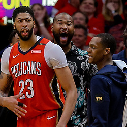 Apr 19, 2018; New Orleans, LA, USA; New Orleans Pelicans forward Anthony Davis and center DeMarcus Cousins and guard Rajon Rondo and center Emeka Okafor (left to right) celebrate from the bench  during the fourth quarter in game three of the first round of the 2018 NBA Playoffs against the Portland Trail Blazers at the Smoothie King Center. The Pelicans defeated the Trail Blazers 119-102.  Mandatory Credit: Derick E. Hingle-USA TODAY Sports