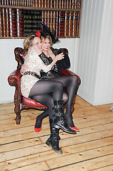 Left to right, LARA CAZALET and JACQUETTA WHEELER at a party to celebrate the 1st anniversary of Alice Temperley's label held at Paradise, Kensal Green, London W10 on 25th November 2010.