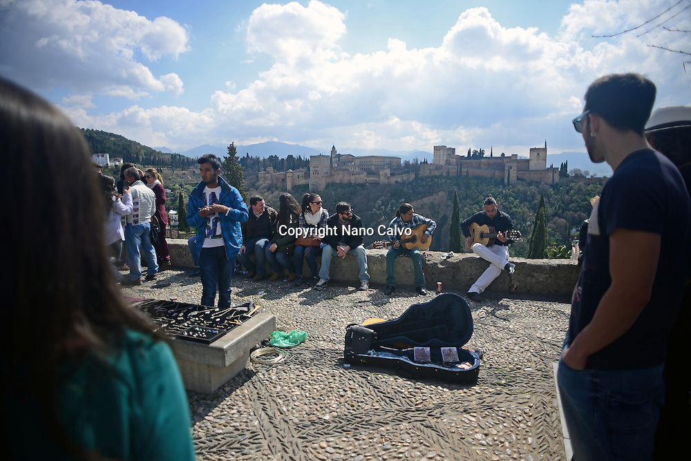 Flamenco singers at Mirador de San Nicolas (San Nicolas Viewpoint) in The Albaicin Quarter, the old Moorish quarter across the River Darro from the Alhambra
