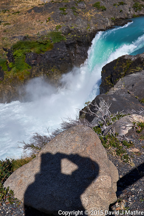 Selfie Shadow and Waterfall in Torres del Paine National Park. Image taken with a Fuji X-T1 camera and Zeiss 32 mm f/1.8 lens.