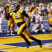 Tupelo's Jaquerrious Williams celebrates scoring a touchdown during Friday night's game against Oxford.
