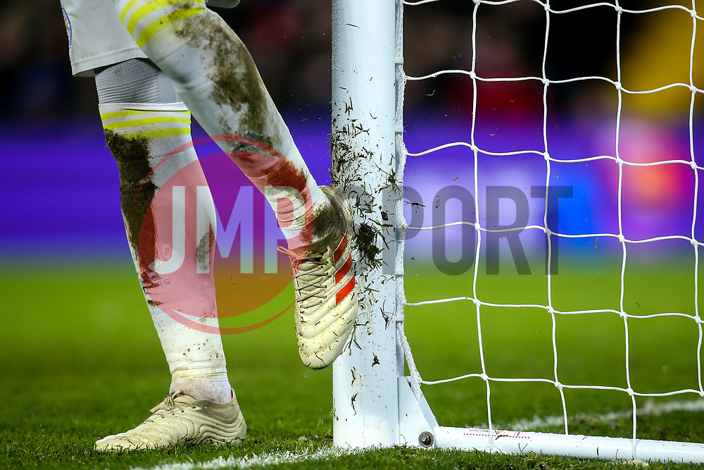 Kasper Schmeichel of Leicester City cleans his boots clean on the goal post - Mandatory by-line: Robbie Stephenson/JMP - 30/01/2019 - FOOTBALL - Anfield - Liverpool, England - Liverpool v Leicester City - Premier League