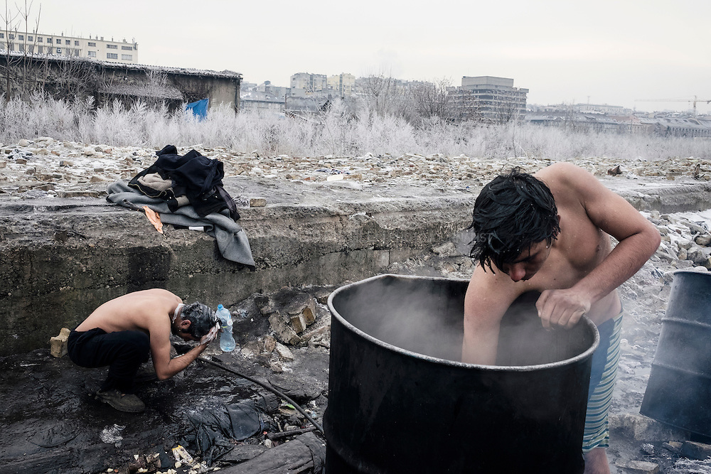Afghan refugees wash theirself outside of a warehouse in Belgrade. Up to 1500 migrants are trying to survive the freezing Serbian winter in a crumbling building with broken windows, no electricity, no heating, or water. They are surviving without sanitation and in a sub-zero winter.