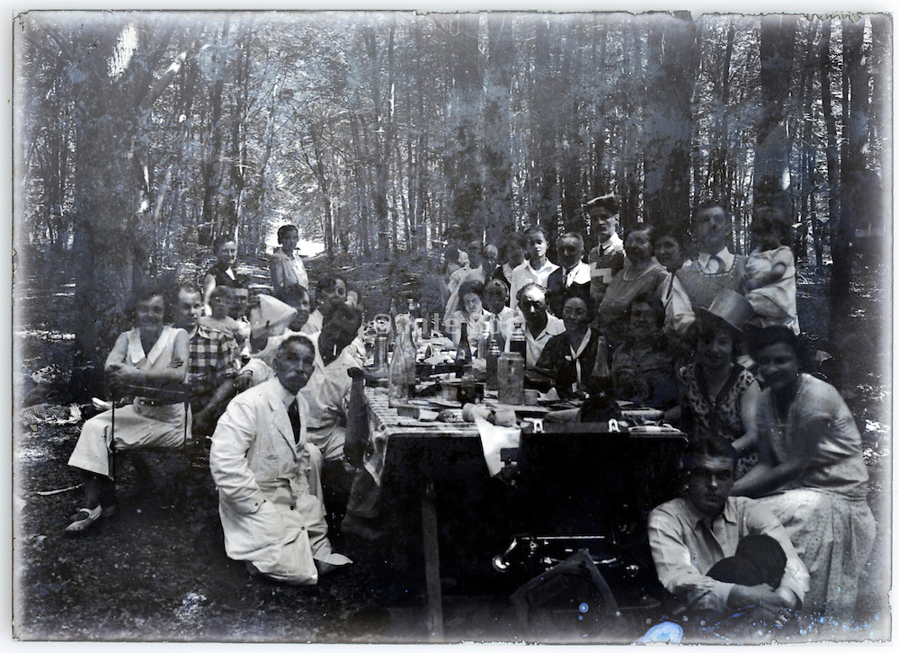 very large extended family gathering picnic in the woods vintage 1900s