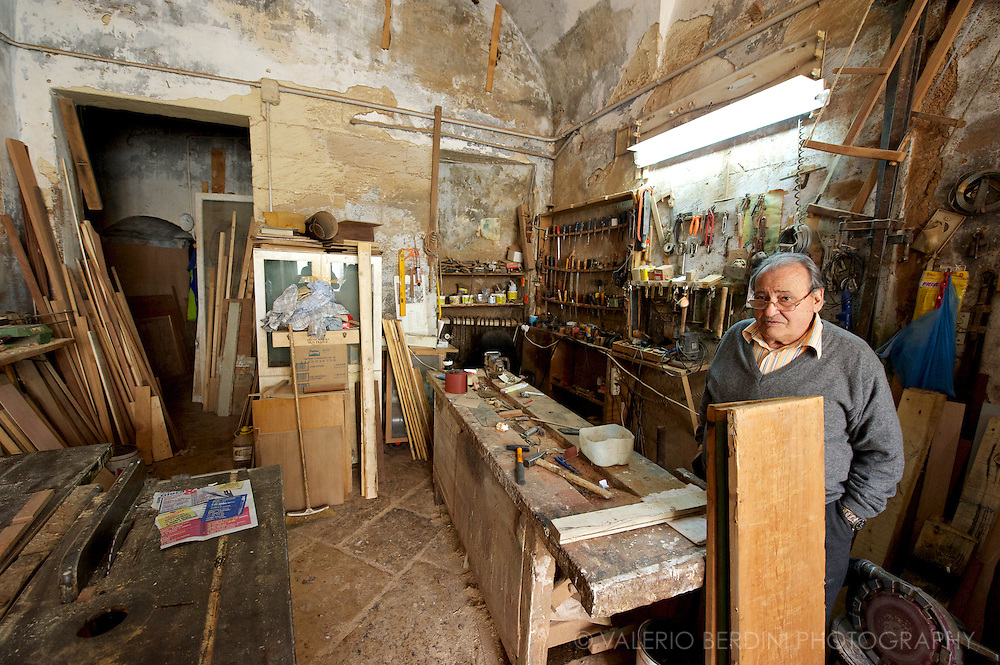 A carpenter in his workshop. His sons moved north Italy to look for a different job.