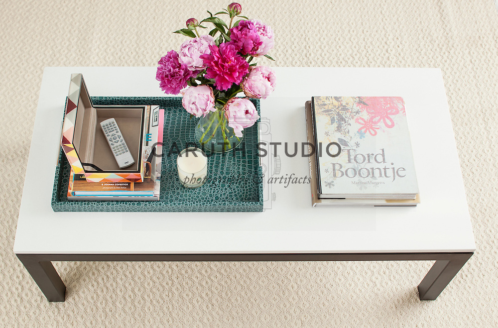 How to Style a Coffee Table: step five, add decorative box to hide remotes