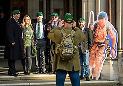 © Licensed to London News Pictures.28/03/2017.London, UK. Former Royal Marines pose for a photograph with a cardboard cutout image of Sgt Blackman as they arrive at the Royal Courts of Justice in London, where a judge reduced the sentence for Sgt Blackman's manslaughter charge, meaning he will be free within weeks..Photo credit: Ben Cawthra/LNP
