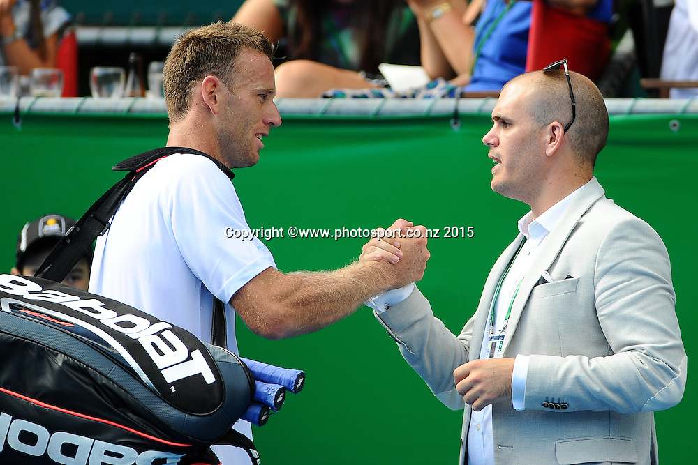 Michale Venus from New Zealand shakes hand with Tournament director Karl Budge after his singles match lost to Lucas Pouille from France at the Heineken Open. ASB Tennis Centre, Auckland, New Zealand. Wednesday 14 January 2015. Copyright photo: Chris Symes/www.photosport.co.nz