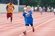 Middletown, New York - A young boy competes in a race during the Twilight Track and Field Series run by the Middletown High School Varsity track program on July 22, 2014.