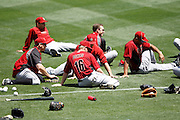 LOS ANGELES, CA - MAY 27:  Matt Downs #16 of the Houston Astros and teammates lie on the grass while stretching before the game against the Los Angeles Dodgers on Sunday, May 27, 2012 at Dodger Stadium in Los Angeles, California. The Dodgers won the game 5-1. (Photo by Paul Spinelli/MLB Photos via Getty Images) *** Local Caption *** Matt Downs