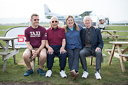 © Licensed to London News Pictures. 25/08/2016. <br /> <br /> Pictured: D-Day veterans Fred Glover (right) and Ted Pieri (left), pose for a group photograph with members of the Taxi charity.<br /> <br /> Fred Glover and Ted Pieri, two D-Day veterans who are both 90 years old have parachuted into Sarum Airfield, Wiltshire on Thursday 25th August 2016, 72 years after D-Day having earlier in the month parachuted into Merville Battery in France.<br /> <br /> <br /> Photo credit should read Max Bryan/LNP