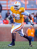 November 27, 2010: Tennessee Volunteers running back Tauren Poole (28) runs with the ball against the Kentucky Wildcats at Neyland Stadium in Knoxville, Tennessee. Tennessee won by 24 to 14, extending their win streak over Kentucky to 26 straight. (cover image for Sports Illustrated's 2011 SEC Preview)