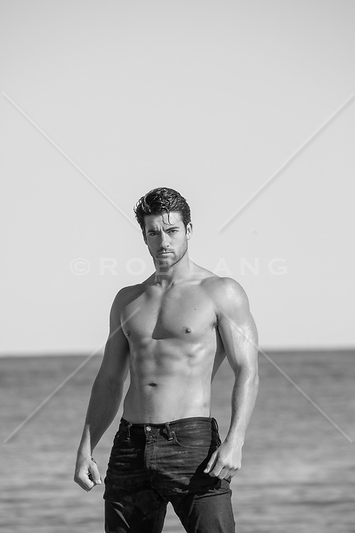hot shirtless man at the ocean
