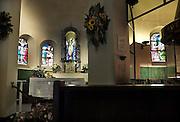De Kapel Onze Lieve Vrouw van Genooi is een kleine rooms katholieke kapel in Venlo en stamt uit 1423, gebouwd naar het voorbeeld van de kapel van Loreto in Italië. In 1917 werd de kapel gerestaureerd en vergroot naar een ontwerp van de Roermondse bouwmeester Pierre Cuypers. Ondanks de secularisatie geniet de kapel nog altijd grote belangstelling, met name van wandelaars die de Pieterpad-route nemen en pelgrims uit zowel de Noord-Limburgse regio als het Duitse grensgebied. Maar ook Venlonaren bezoeken de kapel regelmatig, voor troost, genezing, vergeving of bemoediging door middel van het branden van een kaars. Lieve Vrouw Hulp der Christenen, zoals de officiele titel van Maria van Genooi luidt, is deel van de christelijke volksdevotie in Venlo. Elke maand worden er gemiddeld 15.000 kaarsen aangestoken.Foto: Flip Franssen