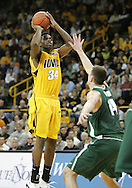 04 JANUARY 2007: Iowa forward Tyler Smith (34) shoots over Michigan State center Goran Suton (14) in Iowa's 62-60 win over Michigan State at Carver-Hawkeye Arena in Iowa City, Iowa on January 4, 2007.