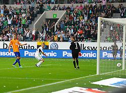 01.09.2013, Volkswagen Arena, Wolfsburg, GER, 1. FBL, VfL Wolfsburg vs Hertha BSC, 4. Runde, im Bild Torschuetze Ivica Olic (VfL Wolfsburg) blickt nach seinem tor zum 1:0 noch einmal in Richtung Linienrichter, Thomas Kraft (Hertha BSC) geschlagen // during the German Bundesliga 4th round match between VfL Wolfsburg and Hertha BSC at the Volkswagen Arena, Wolfsburg, Germany on 2013/09/01. EXPA Pictures © 2013, PhotoCredit: EXPA/ Eibner/ Global<br /> <br /> ***** ATTENTION - AUSTRIA ONLY *****
