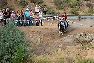 The lead suicide racer, Riley Preston starts down the river bank during the Vale 4th of July Rodeo on July 2, 2016 in Vale, Oregon.
