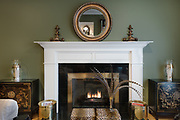 Green living room with fireplace by Rodney Bedsole, an architecture photographer based in Nashville and New York
