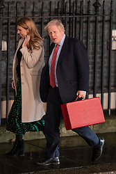 © Licensed to London News Pictures. 13/12/2019. London, UK. Prime Minister Boris Johnson and girlfriend Carrie Symonds arrive at Downing Street as the Conservative party win a landslide victory in last night's General Election. Photo credit: Alex Lentati/LNP
