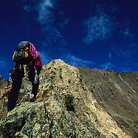 Matt Scullion blazing a trail under blue skies up the technical arete of Mount Superior, Little Cottonwood Canyon, Utah