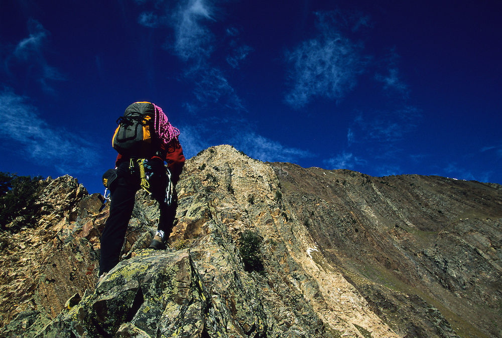 Matt Scullion blazing a trail under blue skies up the technical arete of Mount Superior, Little Cottonwood Canyon, Utah