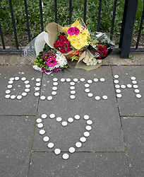 © Licensed to London News Pictures. 20/03/2017. London, UK. Candles and flowers left in the name of Dutch, believed to be the nick name of the victim of a fatal shooting in Barking,  are placed near where an 18 year old man was shot in the head on Sunday evening. Photo credit: Peter Macdiarmid/LNP