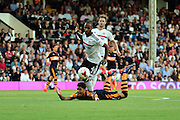 Newcastle United forward Ayoze Perez (17) gets pushed for the first foul during the EFL Sky Bet Championship match between Fulham and Newcastle United at Craven Cottage, London, England on 5 August 2016. Photo by Jon Bromley.