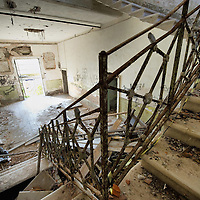 VENICE, ITALY - AUGUST 27: Ruined staircase is seen in the main hall of the abandoned Hospital of Poveglia on August 27, 2011 in Venice, Italy. The island of Poveglia, with its ruined hospital and plague burial grounds, is said to be the most haunted location in the world. Though it is a multi-million dollar piece of real estate it lies deserted and off limits to the public. Its dark, forbidding shores are only minutes away from the glamour of the Venice Film Festival on the ...To discuss licensing our 4000 word photo documentary of the island, email robin@robinsaikia.com. ..British author Robin Saikia visited the site with Italian photographer Marco Secchi. Marco captured the sinister atmosphere of the island. Robin describes the terrifying apparitions and the stories behind them.