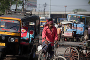 A boy is driving his bicycle in the mids of heavy traffic on the streets of Agra. The Taj Mahal has been struggling to keep in shape also because of the high levels of pollution in the city, mainly caused by congested roads and high levels of traffic, vehicles and an increasing population, in Agra.