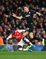 Football - 2019 / 2020 Premier League - Arsenal vs. Brighton & Hove Albion<br /> <br /> Arsenal's Nicolas Pepe is fouled by Brighton & Hove Albion's Dan Burn, at The Emirates.<br /> <br /> COLORSPORT/ASHLEY WESTERN