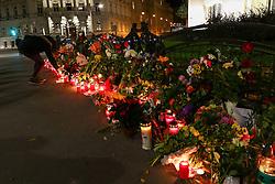 14.11.2015, Botschaft der Französischen Republik, Wien, AUT, Terroranschläge von Paris, Gedenken in Österreich, im Bild ein Mädchen bei den Kerzen und Blumen vor der Botschaft. Bei einer Serie von Terroranschlägen in Paris wurden mindestens 128 Menschen getötet. Terroristen hatten in der Nacht bei Angriffen mit Schusswaffen und Bombenanschlägen gezielt Anschläge auf Frankreich verübt // A girl with the candles and flowers in front of the embassy. French President Francois Hollande said more than 120 people died Friday night in shootings at Paris cafes, suicide bombings near France national stadium and a hostage- taking slaughter inside a concert hall, at the French embassy in Vienna, Austria, EXPA Pictures © 2015, PhotoCredit: EXPA/ Sebastian Pucher