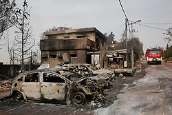 May 24, 2019: Mevo Modi'In, Israel: Burnt-down vehicles following a fire amidst extreme heat wave in the village of Mevo Modi'im, Israel. The Israeli government said it is asking for international aid to fight dozens of huge fires that broke out on Thursday because of extreme hot weather of more than 40 degrees Celsius. (Credit Image: © Gil Cohen Magen/Xinhua via ZUMA Wire)