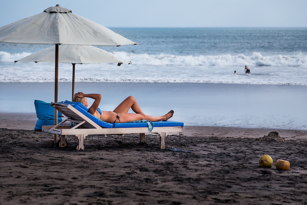 A woman relaxes at Echo beach, Canggu.