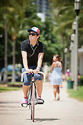 This set of five images were all taken from one spot. I sat down on the curb near Queen's Beach in Waikiki and waited for things to change around me. Ususally I move around way too much but I changed my strategy to see how it goes.