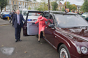 Queen Elizabeth exits her Bentley limousine to make a brief visit to the Ebony Horse Club at Loughborough Junction, Brixton, London. Accompanied by the Duchess of Cornwall, Her Majesty watched an equestrian demonstration in one of the most disadvantaged inner city neighbourhoods in the country where there is a historic legacy of under-achievement in schools, high rates of teenage pregnancy and negative stereotypes of young people, gang violence and drug related crime.