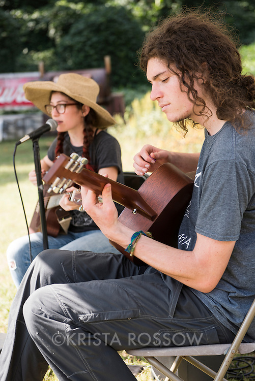 Musicians Kayla Zuskin and Stephen Horvath play together as Fort in the Sky during the weekly River Arts District Farmers Market, which is held Wednesdays at 175 Clingman Avenue (next to All Souls Pizza) in the River Arts District of Asheville, North Carolina.