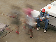 HOUSTON - September 3: A man eats his lunch on the floor of the Reliant Astrodome as fellow refugees pass by Saturday, Sept. 3, 2005. Houston's Reliant Astrodome is filled to capacity as are many other area shelters.<br />