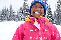 Young girl playing in snow at Kirkwood ski resort near Lake Tahoe, CA.