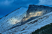 Storm light on mountain peaks near Big Bend. The Icefields Parkway.<br />