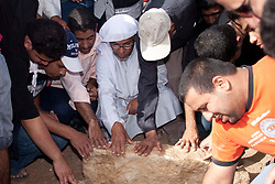 © under license to London News Pictures.  18/02/2011. People mourn the death Ali Al Almoumen, the third person to be buried in Sitra today after he was killed on Wednesday at the Pearl Roundabout.  Photo credit should read Michael Graae/London News Pictures