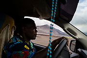 A driver navigates his way across the large ash plains surrounding Yasur volcano, there is now a river crossing which was caused by a natural dam bursting upstream.