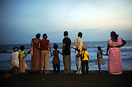 People look out over the ocean in Colombo, Sri Lanka, July 5, 2009. With the end of the 26 war between the Sri Lankan government and the LTTE, security in the capital city remains on high alert.