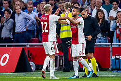 14-08-2018 NED: Champions League AFC Ajax - Standard de Liege, Amsterdam<br /> Third Qualifying Round,  3-0 victory Ajax during the UEFA Champions League match between Ajax v Standard Luik at the Johan Cruijff Arena / Hakim Ziyech #22 of Ajax, Zakaria Labyad #19 of Ajax