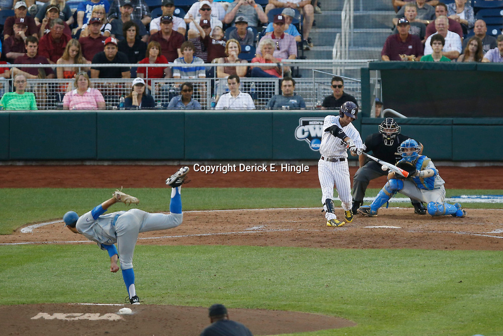 Jun 24, 2013; Omaha, NE, USA; Mississippi State Bulldogs second baseman Brett Pirtle (third from right) hits a single against UCLA Bruins starting pitcher Adam Plutko (far left) during the fourth inning in game 1 of the College World Series finals at TD Ameritrade Park. Mandatory Credit: Derick E. Hingle-USA TODAY Sports