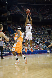 Virginia Cavaliers guard J.R. Reynolds (2) shoots over Tennessee Volunteers forward Wayne Chism (4) .  The #4 seed Virginia Cavaliers were defeated by the #5 seed Tennessee Volunteers 77-74 in the second round of the Men's NCAA Tournament in Columbus, OH on March 18, 2007.