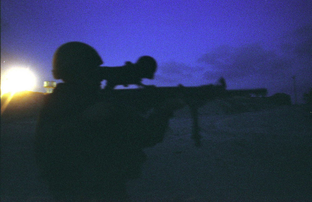 "Israeli special forces during a night operation in Rafah, in the Gaza Strip, to find weapons smuggling tunnels near the ""Philadephi Road,"" a stretch of road that runs along Gaza's border with Egypt in 2004."